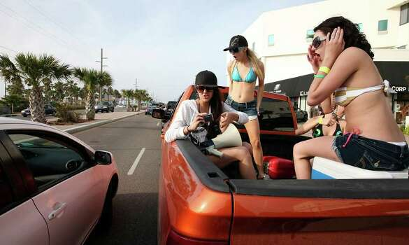 "Spring breakers cruise Padre Boulevard Sunday March 13, 2011 during ""Texas Week""  on South Padre Island. Photo: EDWARD A. ORNELAS, Express-News / SAN ANTONIO EXPRESS-NEWS NFS"