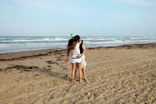 "Alexis Lopez, 27, and Lee Newbauer, 28 both from Dallas, kiss Sunday March 13, 2011 during ""Texas Week"" on South Padre Island. Photo: EDWARD A. ORNELAS, Express-News / SAN ANTONIO EXPRESS-NEWS NFS"