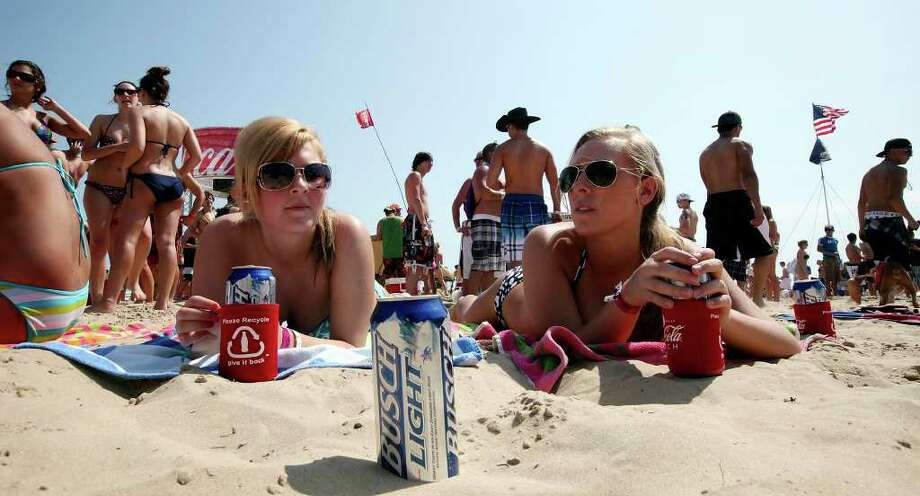 "University of Northern Iowa studetns Rashell Hartl, 21, (left) and Katie Dolezal, 21, relax at Coca-Cola Beach Monday March 14, 2011 during ""Texas Week"" on South Padre Island. Photo: EDWARD A. ORNELAS, Express-News / SAN ANTONIO EXPRESS-NEWS NFS"