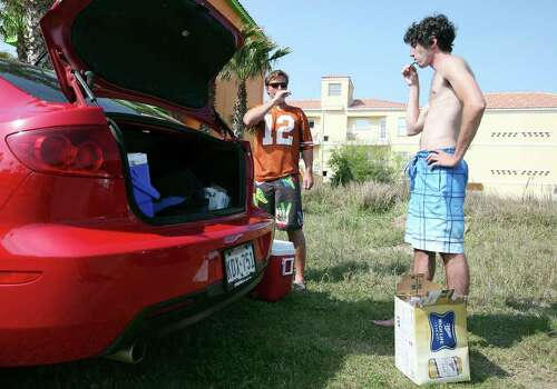 "University of Texas at Austin students Graham Grunow, 22, (left) and Gareth Whitham, 22, brush their teeth before going to the beach Monday March 14, 2011 during ""Texas Week"" at Coca-Cola Beach on South Padre Island. Photo: EDWARD A. ORNELAS, Express-News / SAN ANTONIO EXPRESS-NEWS NFS"