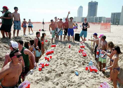 "Spring breakers play beer pong Monday March 14, 2011 during ""Texas Week"" at Coca-Cola Beach on South Padre Island. Photo: EDWARD A. ORNELAS, Express-News / SAN ANTONIO EXPRESS-NEWS NFS"