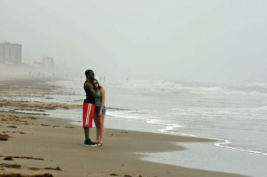Derrick Haygood, 19, (left) and Lauren Morgenstern, 17 both from Dallas, enjoy a morning walk while on spring break Monday March 14, 2011 on South Padre Island. Photo: EDWARD A. ORNELAS, Express-News / SAN ANTONIO EXPRESS-NEWS NFS