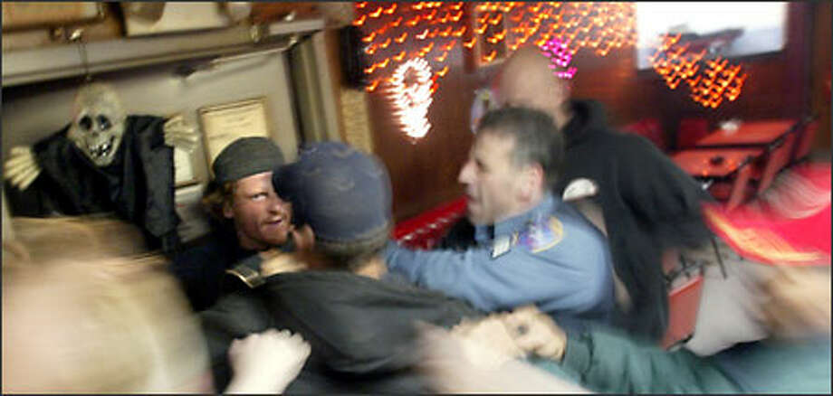A patron is shoved out the door after a fight breaks out in the Elbow Room in Unalaska, Alaska. The bar once had the reputation of being a dangerous place, and it still can be the scene of a certain amount of rowdiness. Photo: Karen Ducey/Seattle Post-Intelligencer