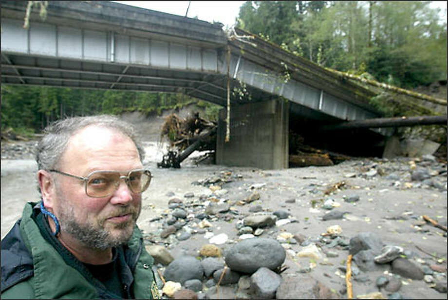 Ranger Terry Skorheim at the Whitechuck Bridge in the Mount Baker-Snoqualmie National Forest, which collapsed in last week's heavy rains. Photo: Karen Ducey/Seattle Post-Intelligencer