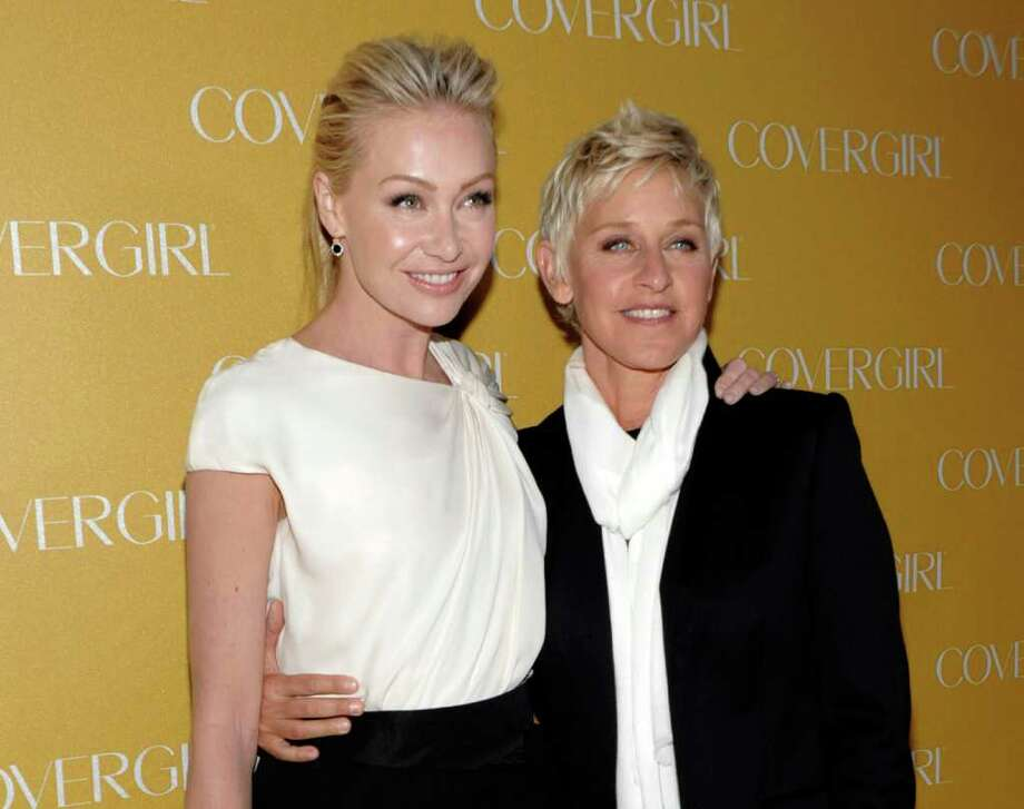 FILE - In this Jan. 5, 2011 file photo, television personality Ellen DeGeneres, right, and actress Portia de Rossi arrive at the COVERGIRL Cosmetics' 50th Anniversary Party in Los Angeles.  (AP Photo/Dan Steinberg, file) Photo: Dan Steinberg