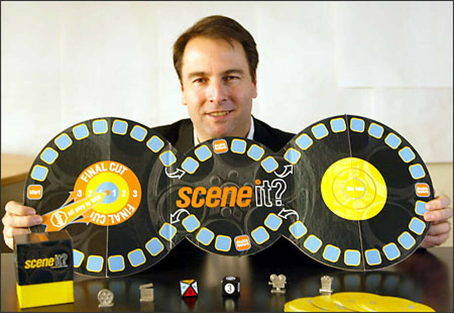 Dave Long, co-founder of Screenlife, with the company's DVD trivia game, SceneIt? Long says Screenlife appeals to investors burned by high tech. Photo: Phil H. Webber/Seattle Post-Intelligencer