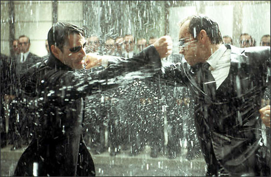 "Neo (Keanu Reeves), left, again faces off against Agent Smith (Hugo Weaving) in ""The Matrix Revolutions."" Seekers of religious content point out that Neo is Greek for ""new"" and an anagram for ""One,"" as in ""The One."" Photo: Warner Bros."