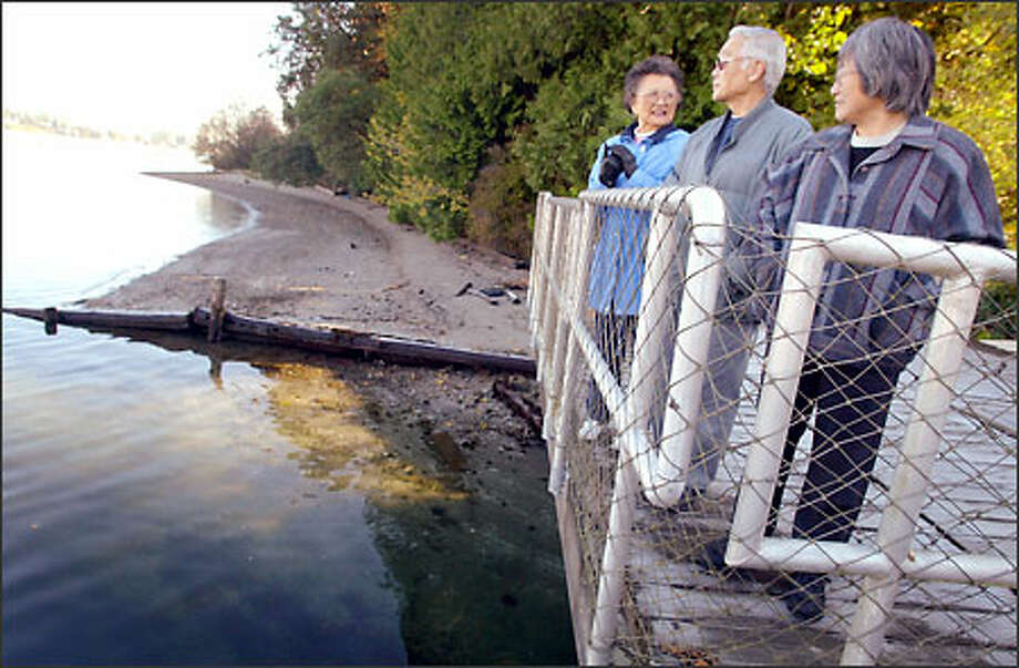 "Kazuko ""Kay"" Nakao, Jim Matsudaira and Hisa Matsudaira talk about the former dock on Bainbridge Island from which Japanese Americans were sent to internment camps. Photo: Joshua Trujillo/Seattle Post-Intelligencer"