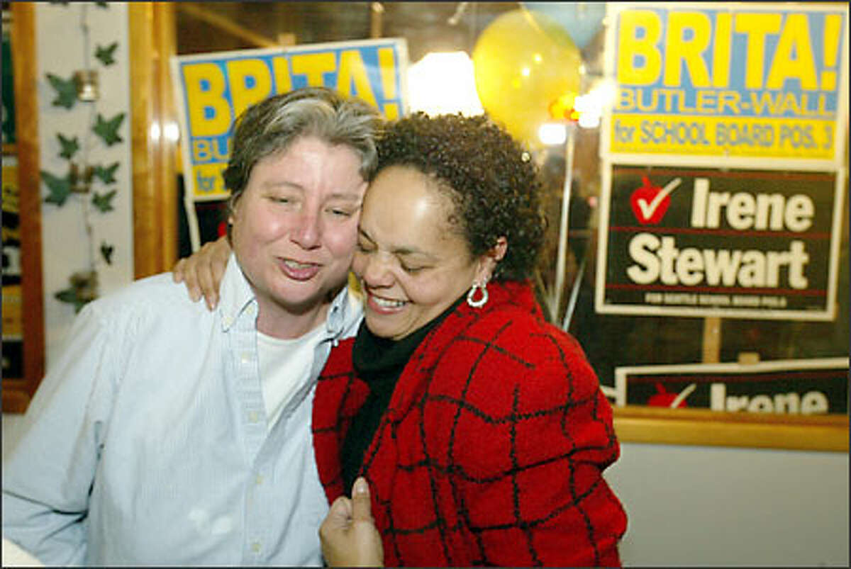 Seattle School Board candidate Darlene Flynn, right, gets a hug from supporter Sarah Luthens at Zoey's Blue Plate Bistro, where four School Board challengers met for a party.