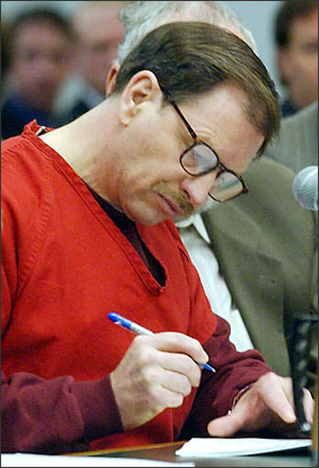 Green River Killer Gary Ridgway listens as individual guilty pleas are read on Tuesday, November 5, 2003, in the King County Courthouse in Seattle. Defense attorney Anthony Savage is at right. Ridgway pleaded guilty to 48 counts of murder. Photo: / Associated Press