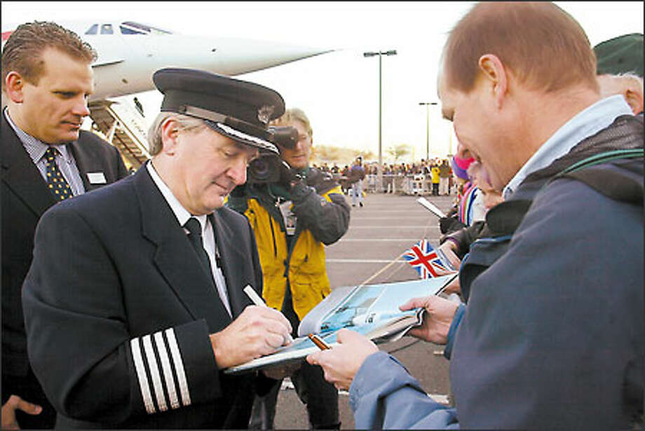 British Airways Capt. Mike Bannister, a Concorde pilot, signs autographs after landing the plane at Boeing Field earlier this week. Photo: Grant M. Haller/Seattle Post-Intelligencer