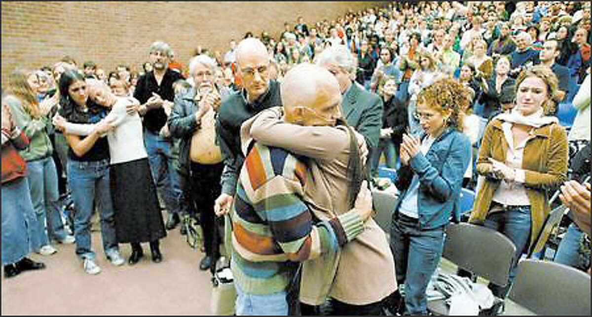 Students, faculty members and friends surround Jim Clowes after he gave what likely will be his last lecture at the University of Washington. He had to stop several times to gain strength.
