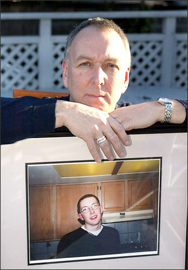 George Fraser holds a picture of his son Geoff, who was killed by a drunken driver. Fraser is wearing two silver rings on his right hand that Geoff wore. Fraser and others believe that their talks to drunken drivers help to save lives or change behaviors by making a lasting impression. Photo: Scott Eklund/Seattle Post-Intelligencer