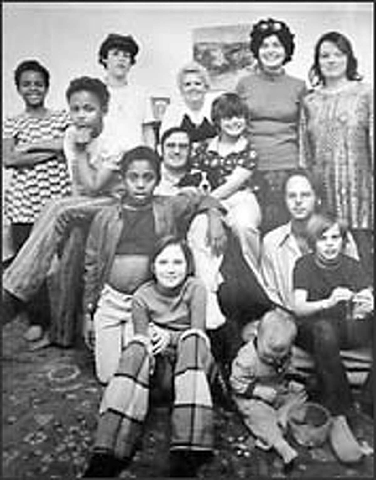 Everyone in this 1975 photograph except Dominique, second from top right, the woman standing to her right and the boy in the rear wearing a hat was killed or committed suicide 25 years ago.