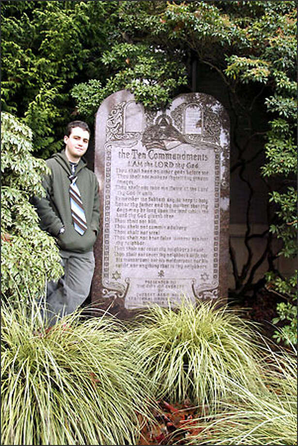 Jesse Card, 20, wants a plaque bearing the Ten Commandments moved away from the Everett Police Station. The plaque is set back from the sidewalk. Photo: Meryl Schenker/Seattle Post-Intelligencer