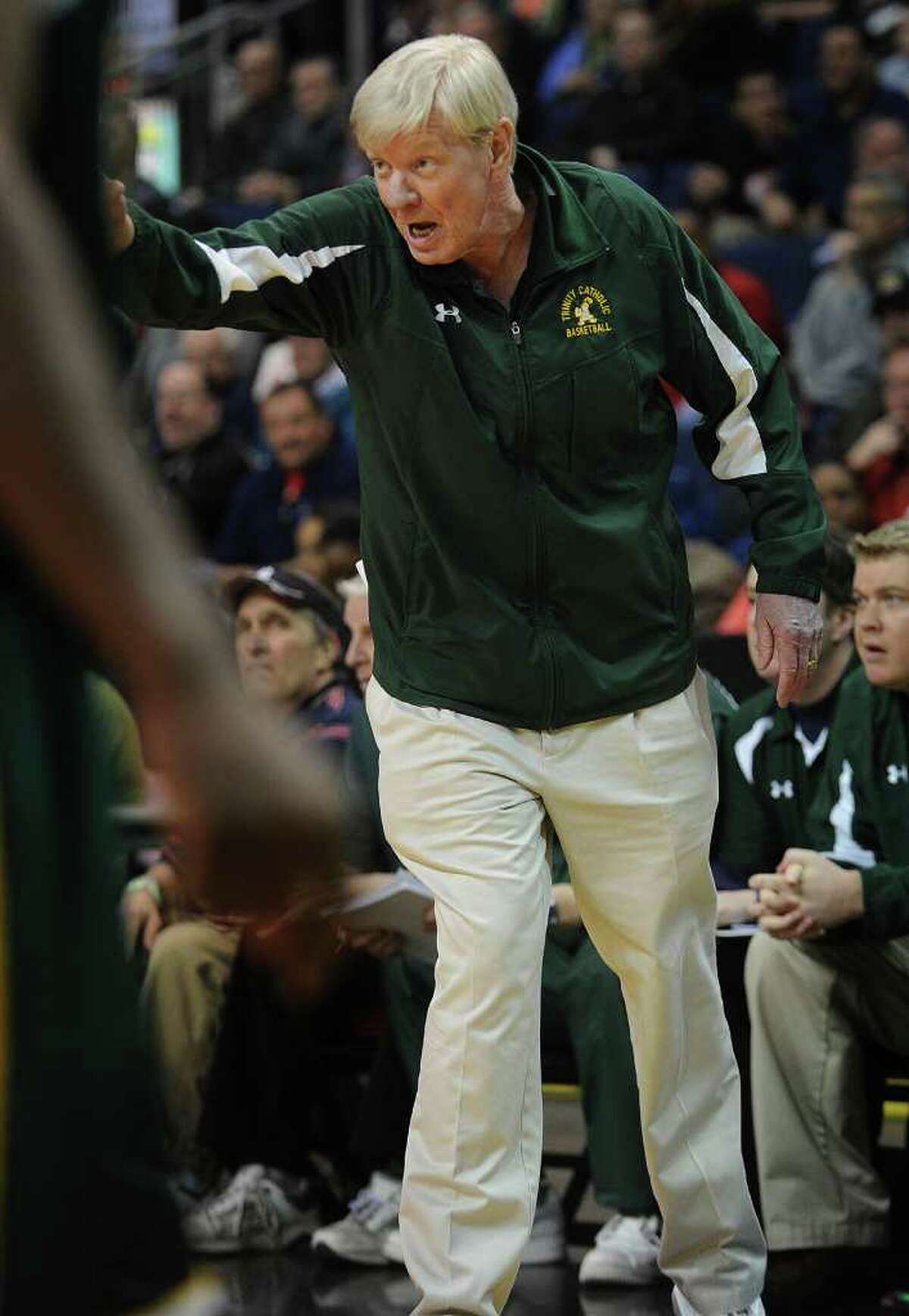 Trinity Catholic boys basketball head coach Mike Walsh during their FCIAC semi-final matchup with Bassick at the Webster Bank Arena at Harbor Yard in Bridgeport on Monday, February 28, 2011.