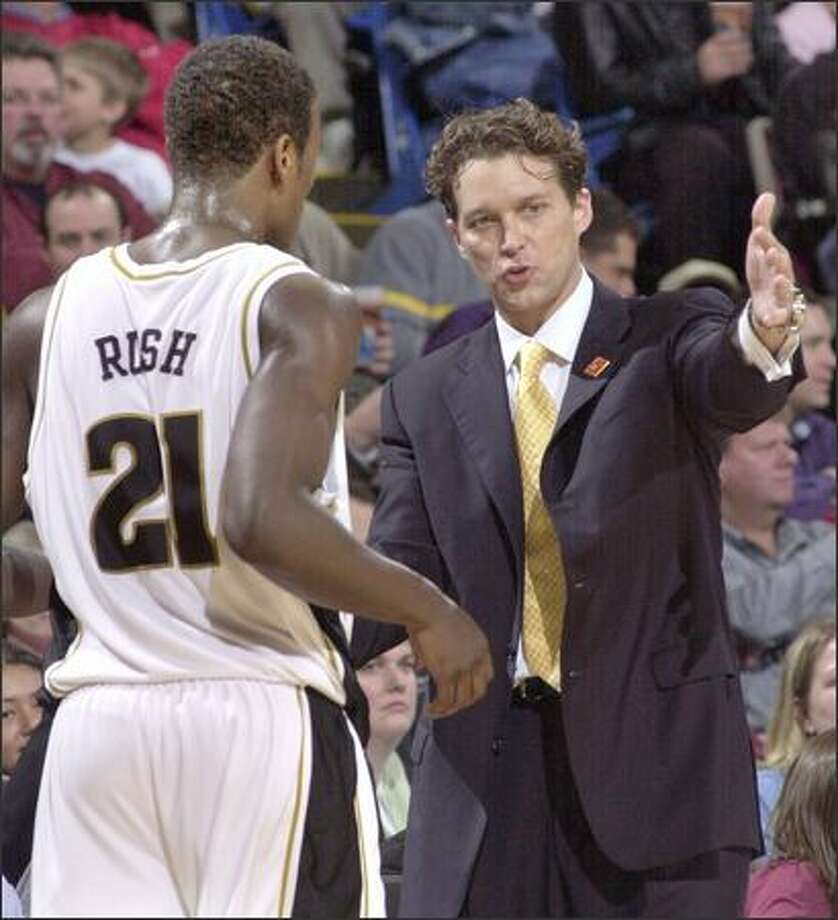 Missouri coach Quin Snyder makes a point to Kareem Rush during last year's Big 12 tournament. In his fifth season with the Tigers, Snyder is 87-49. Photo: / Associated Press
