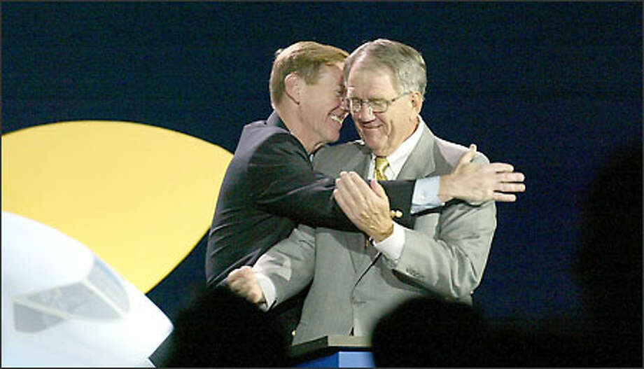 Boeing commercial airplane President Alan Mulally, left, embraces Chief Executive Officer Harry Stonecipher at the convention center, where thousands gathered for the 7E7 announcement. Photo: Gilbert W. Arias/Seattle Post-Intelligencer