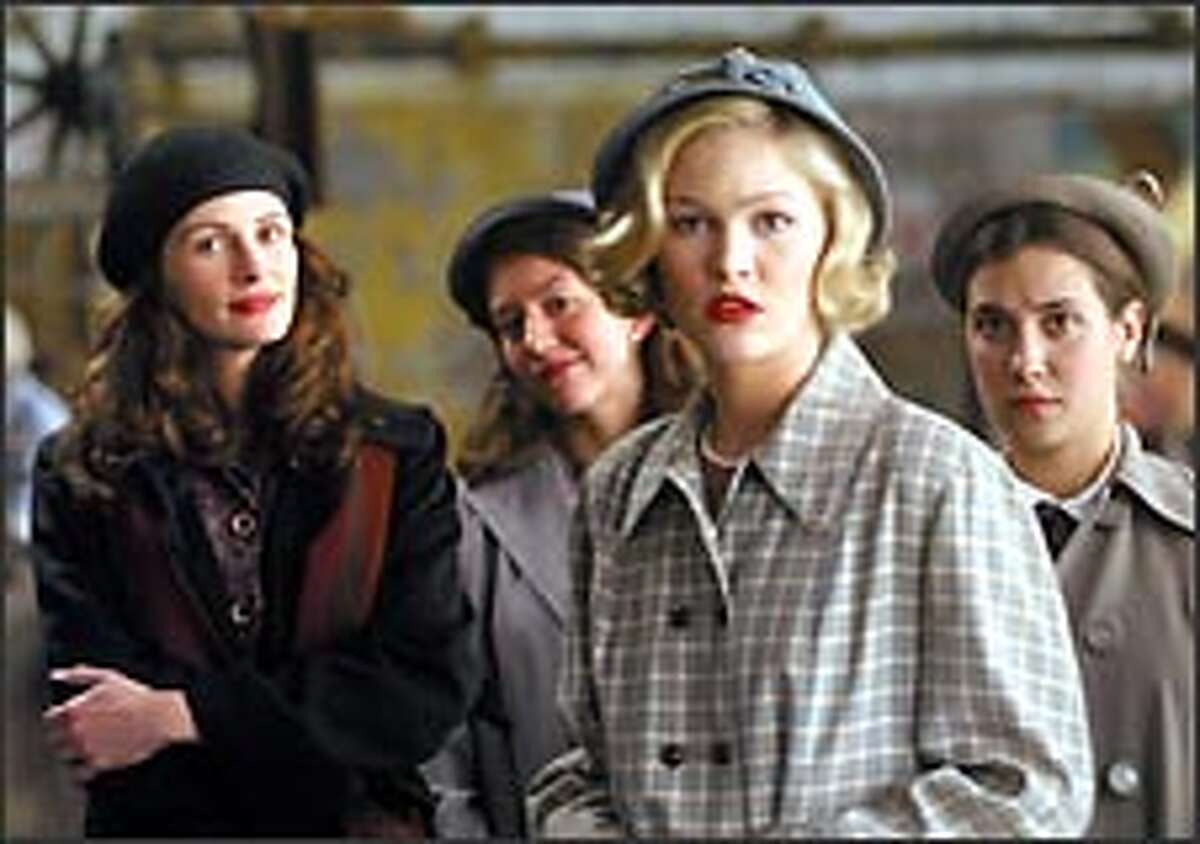 Julia Roberts, left, plays an art teacher at Wellesley College, while Julia Stiles, center, plays a student torn between becoming an attorney or a trophy wife.