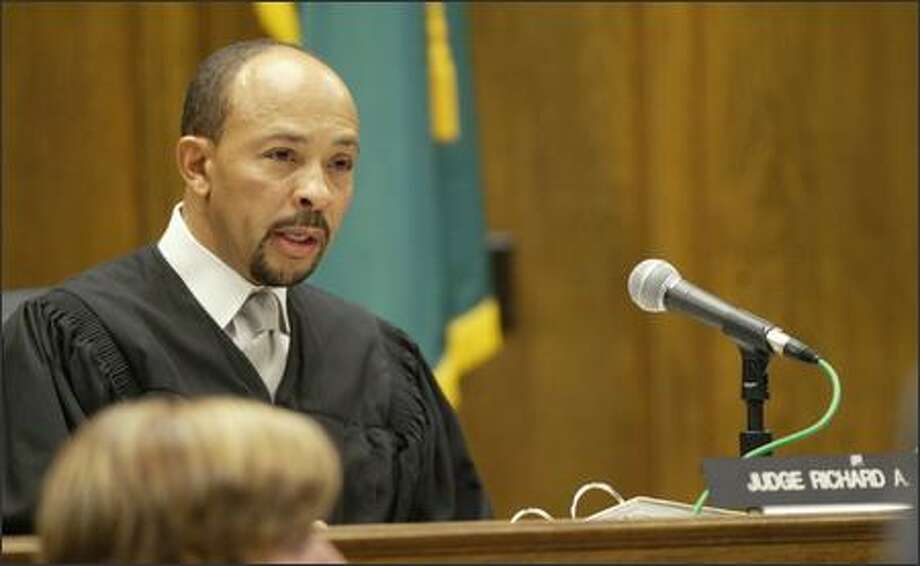 Superior Court Judge Richard A. Jones reads Gary Ridgway's sentence in King County   Superior Court on Thursday Dec. 18, 2003, in Seattle. Ridgway recieved a life sentence without a chance for release for 48 counts of murder in the Green River Killer serial murder case, which began in 1982 and was the largest unsolved serial murder case in American history. (AP Photo/Joshua Trujillo, Seattle Post-Intelligencer, pool) Photo: Joshua Trujillo/Seattle Post-Intelligencer