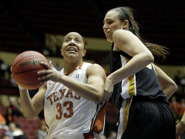 Texas' Ashleigh Fontenette (left) heads to the basket past Missouri's Christine Flores last week during the Big 12 tournament. Jeff Roberson/Associated Press