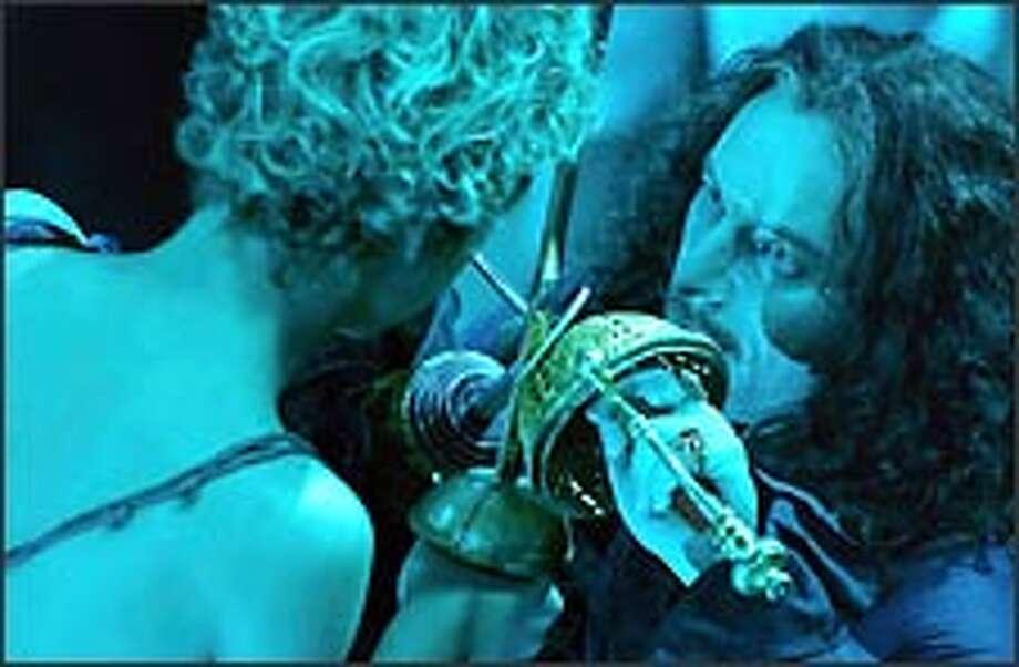 Peter Pan (Jeremy Sumpter, left) locks blades with Captain Hook (Jason Isaacs).