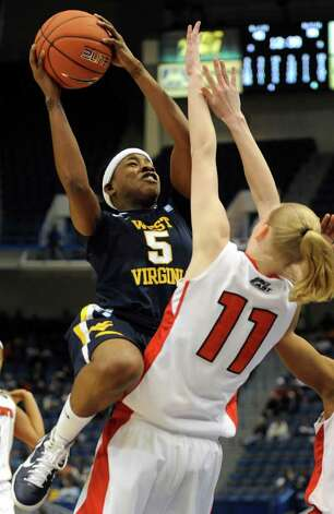 West Virginia's Sarah Miles (left) is fouled St. John's Amanda Burakoski during the second half at the Big East Conference Championships in Hartford, Conn., on March 5. Photo: AP