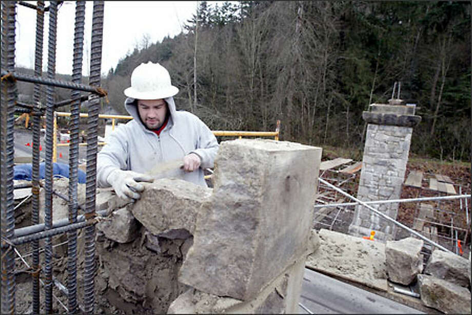 Mike Harstad of All Masonry Inc. of Carnation places a stone in the historic Wilkeson Arch, damaged in the 2001 Nisqually quake. It's being rebuilt a few blocks from its original location. Photo: Scott Eklund/Seattle Post-Intelligencer