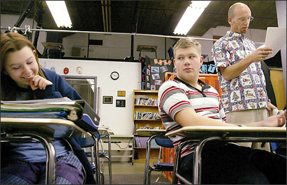 Nicole and Kyle had serious drug problems when they were kicked out of public school. Now they're classmates at Spokane's Summit School, the only drug-recovery high school in Washington. The school caps enrollment at 20 and has just three staff members, including teacher Greg Smith at right. Photo: Paul Joseph Brown/Seattle Post-Intelligencer