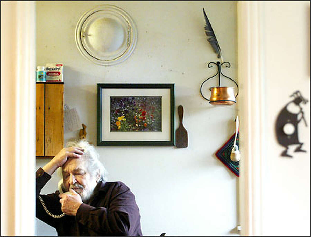 Abe Osheroff talks with a caller in his North Seattle home.