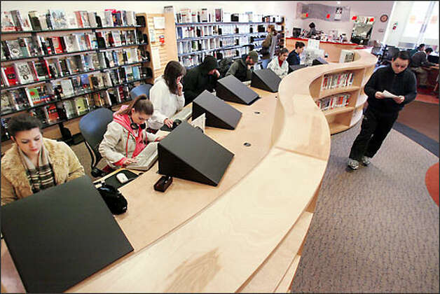 The King County library branch inside the Crossroads Shopping Center has been a hit with people checking out 1,200 to 2,000 items a day. Photo: Paul Joseph Brown/Seattle Post-Intelligencer