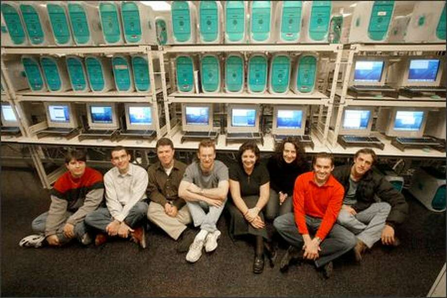 At Microsoft's Macintosh Business Unit are Lyne Brown, Tim McDonough, Jason Blankman, Brent Peterman, Mary Starman, Jennifer Cockrill, Scott Erickson and Geoff Price. Employees in the roughly 160-strong unit make Microsoft software, including Office and Virtual PC, to run on Macs. Photo: Phil H. Webber/Seattle Post-Intelligencer