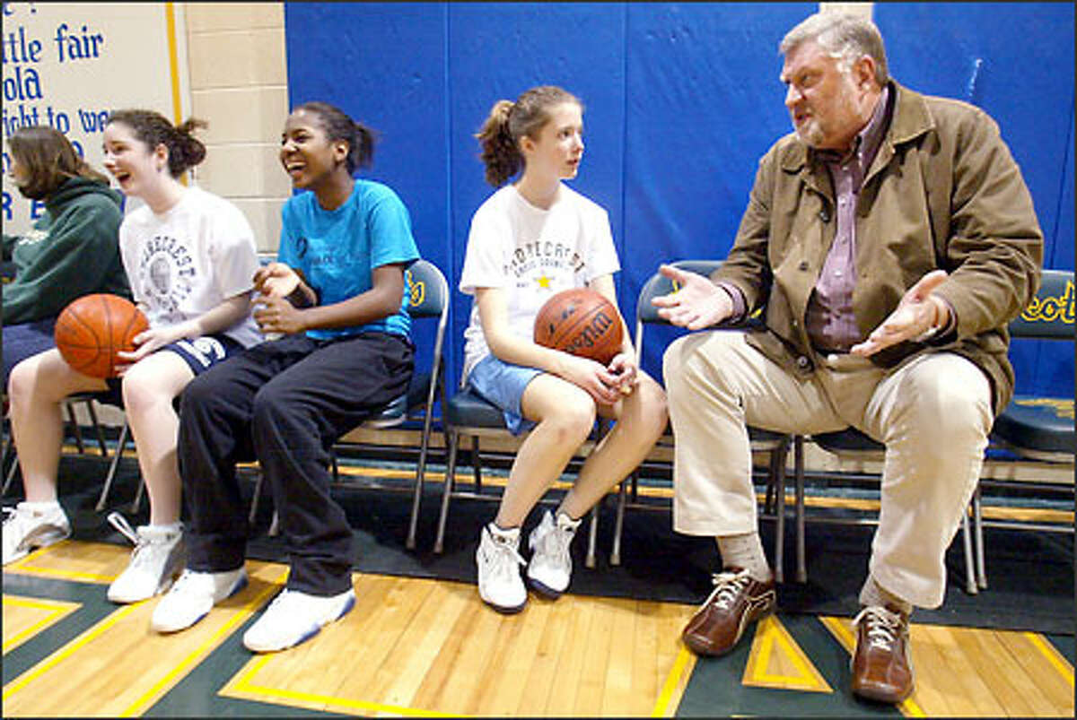 Former Sonic Henry Akin offers advice to Shorecrest's Molly Gibson during a recent practice.
