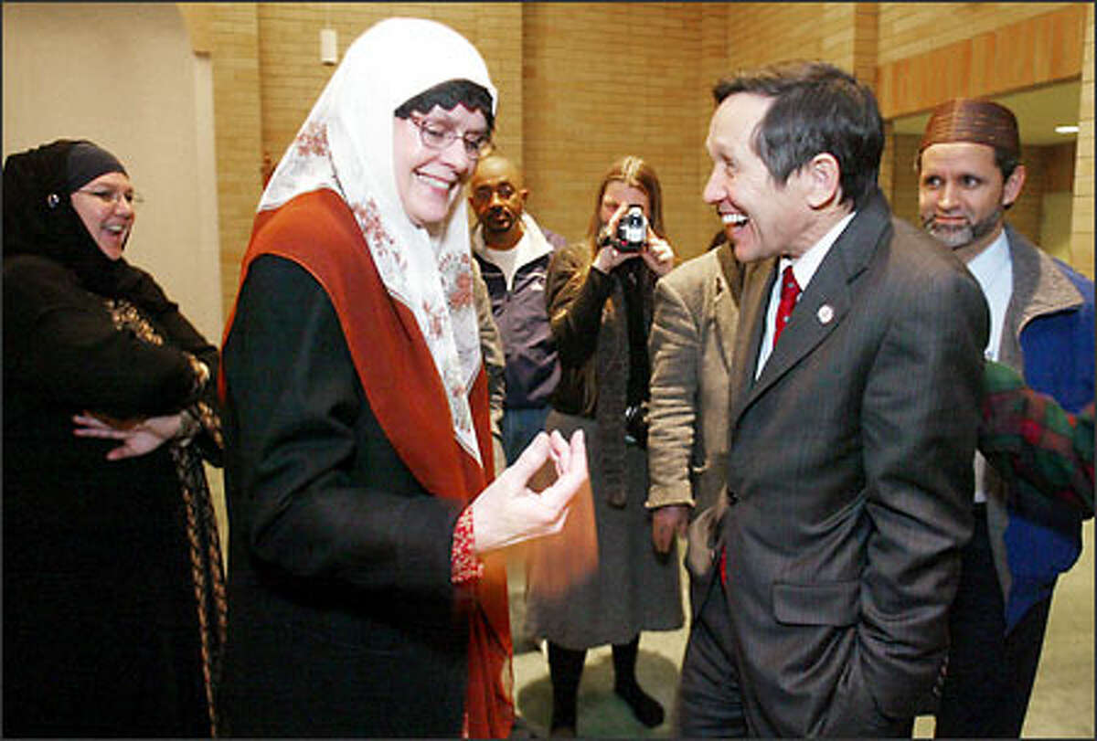 Leslie Sinclair, also known by the Arabic name Munira, expresses her enthusiasm for Dennis Kucinich at Idriss Mosque near Northgate.