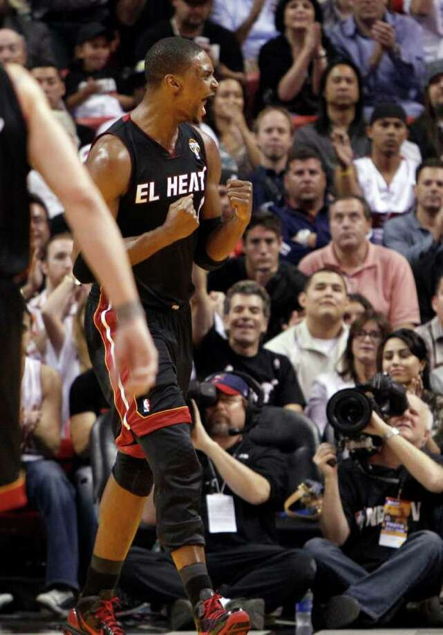 Miami Heat's Chris Bosh celebrates after scoring against the San Antonio Spurs in  the third quarter of an NBA basketball game against the San Antonio Spurs in Miami, Monday, March 14, 2011. The Heat won 110-80. Photo: AP