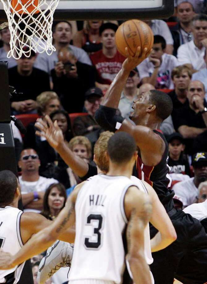 Miami Heat power forward Chris Bosh goes to the basket against the San Antonio Spurs in the third quarter of an NBA basketball game in Miami, Monday, March 14, 2011. The Heat won 110-80. Photo: AP