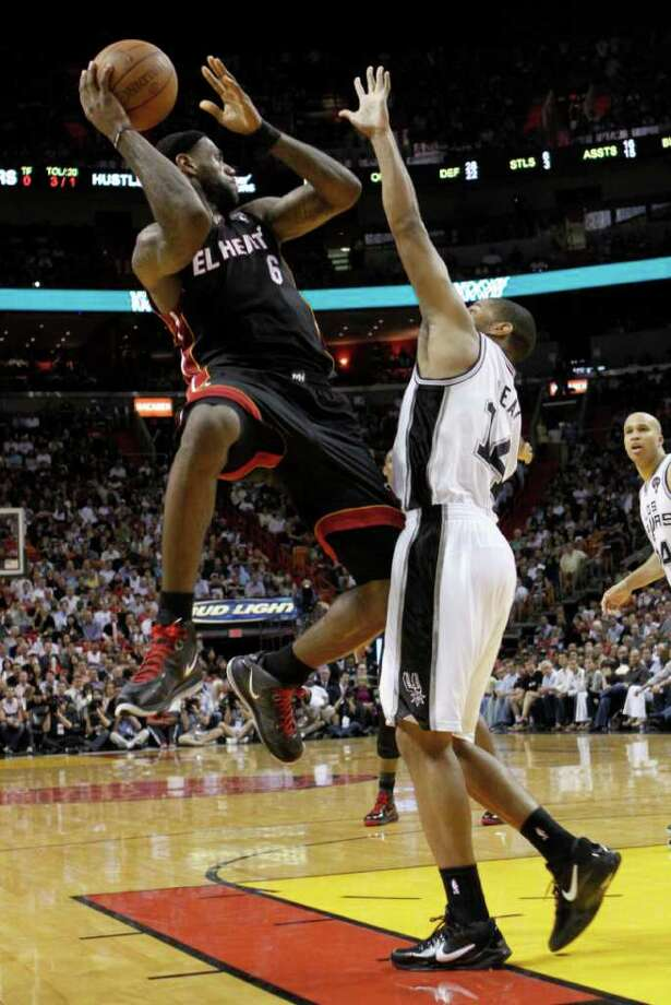 Miami Heat's LeBron James (6) prepares to pass against San Antonio Spurs guard Gary Neal (14) in the fourth quarter of an NBA basketball game in Miami, Monday, March 14, 2011. The Heat won 110-80. Photo: AP