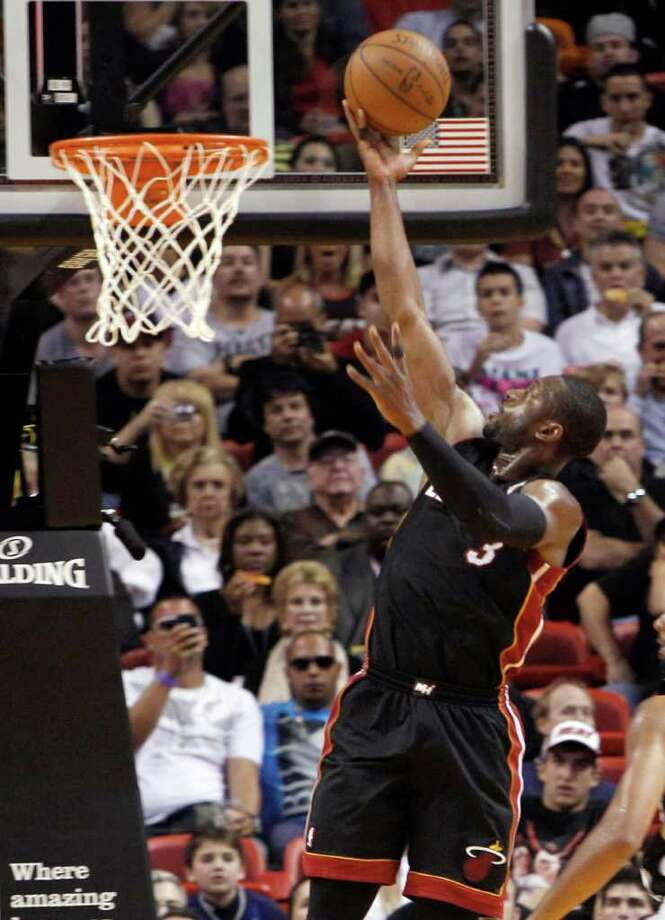 Miami Heat guard Dwyane Wade goes to the basket against the San Antonio Spurs in the first quarter of an NBA basketball game in Miami, Monday, March 14, 2011. Photo: AP