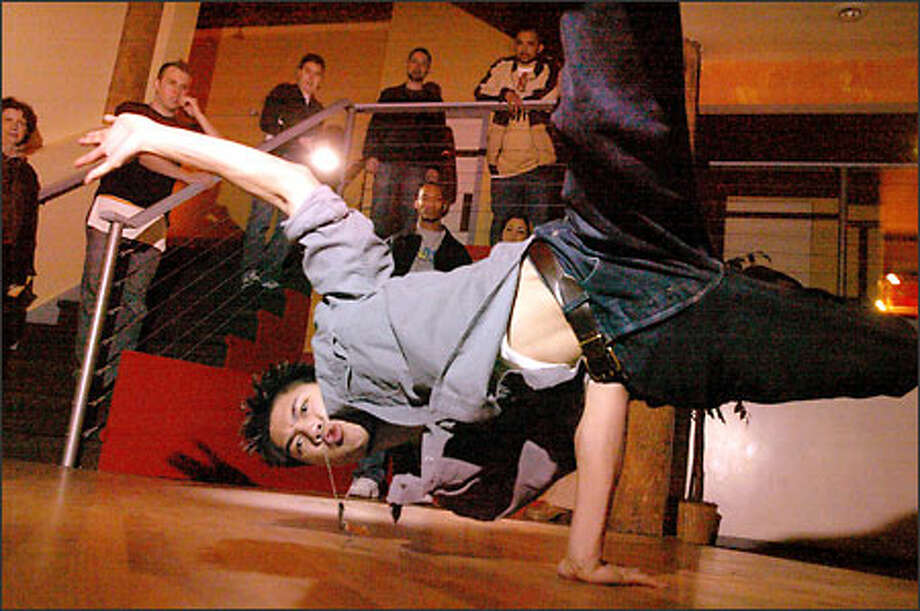 "Jerome ""Jeromeskee"" Aparis, a member of Seattle b-boy hip-hop group Massive Monkees, performs at Caterarts At The Lakeside during a celebration party Wednesday. Aparis was one of four members sent to London for an international competition, and the boys returned with a second-place in the two-man category and a first in four-man competition. Photo: Joshua Trujillo/Seattle Post-Intelligencer"