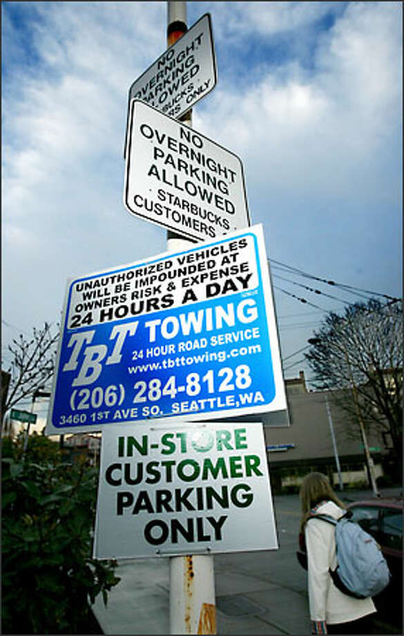 After Starbucks closes, tow trucks have been moving in on this East Olive Way parking lot. Now Starbucks has asked them not to come unless called. Photo: Scott Eklund/Seattle Post-Intelligencer