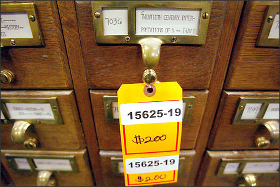 These oak card catalogs with brass handles from the Suzzallo Library go on sale today and tomorrow at 7400 Sand Point Way N.E. Photo: Phil H. Webber/Seattle Post-Intelligencer