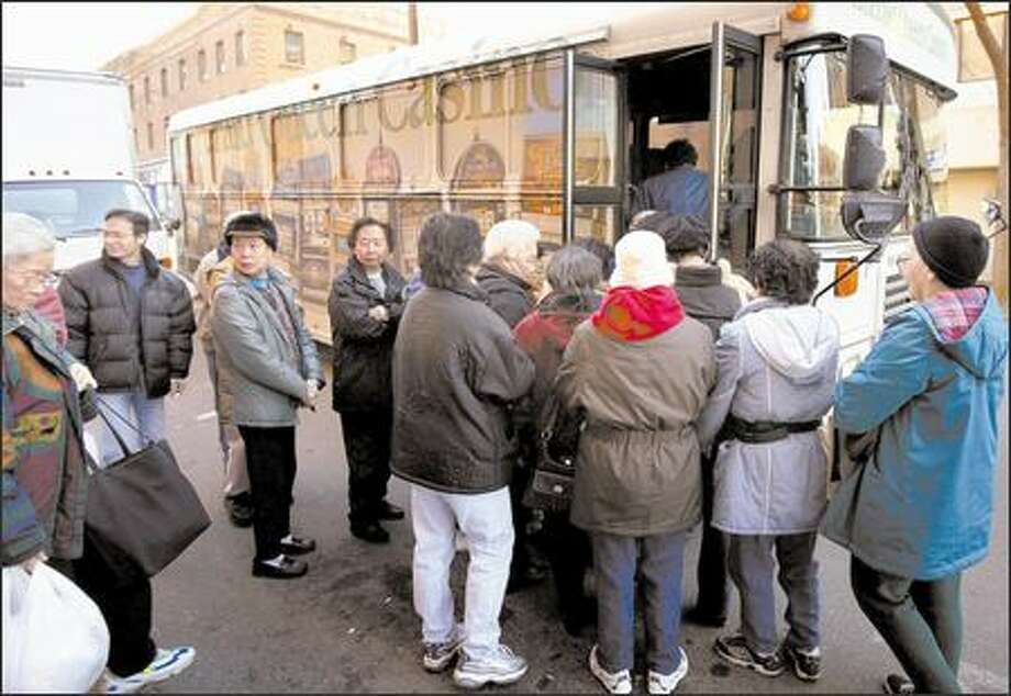 International District gamblers board a bus bound for the Emerald Queen Casino. Asian-themed events, ads and shuttles target the community. Photo: Joshua Trujillo/Seattle Post-Intelligencer