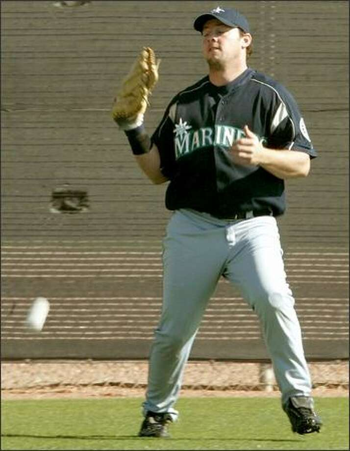 Mariners outfielder Chris Snelling has injured a knee (twice), an ankle, a hand and a thumb since the 2001 season. Photo: MIKE URBAN/P-I