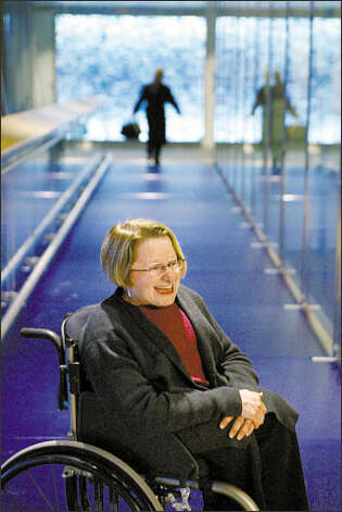 For this blue-glass bridge at the new Seattle City Hall, architect Karen Braitmayer pushed for a surface texture that wouldn't be too slippery for people using crutches or canes. Photo: Meryl Schenker/Seattle Post-Intelligencer
