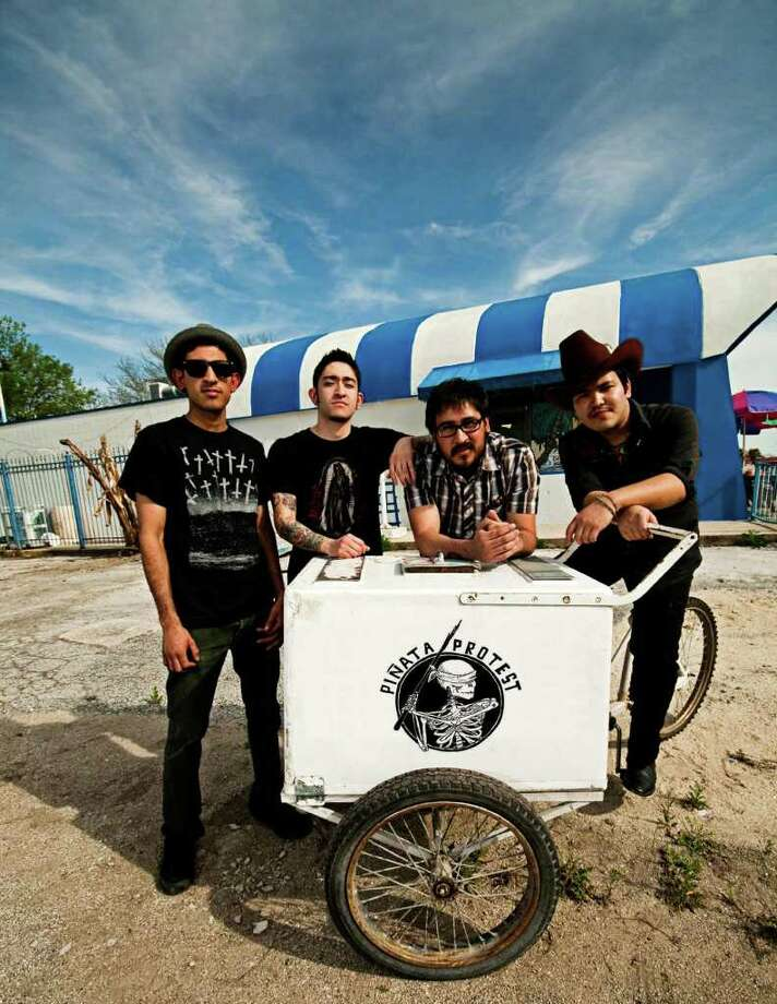 "The members of Pinata Protest are left to right: Marcus Cazares (bass), J.J. Martinez(drums), Matt Cazares(guitar), Alvaro Del Norte (vocals,accordion,trumpet).  The band's debut album is ""Plethora."""