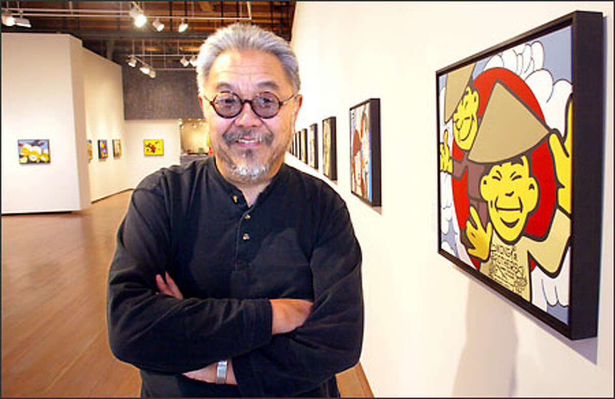 Painter Roger Shimomura poses with his paintings at the Greg Kucera Gallery, 212 Third Ave. S. Beside each acrylic painting is a terse explanation of its contents.