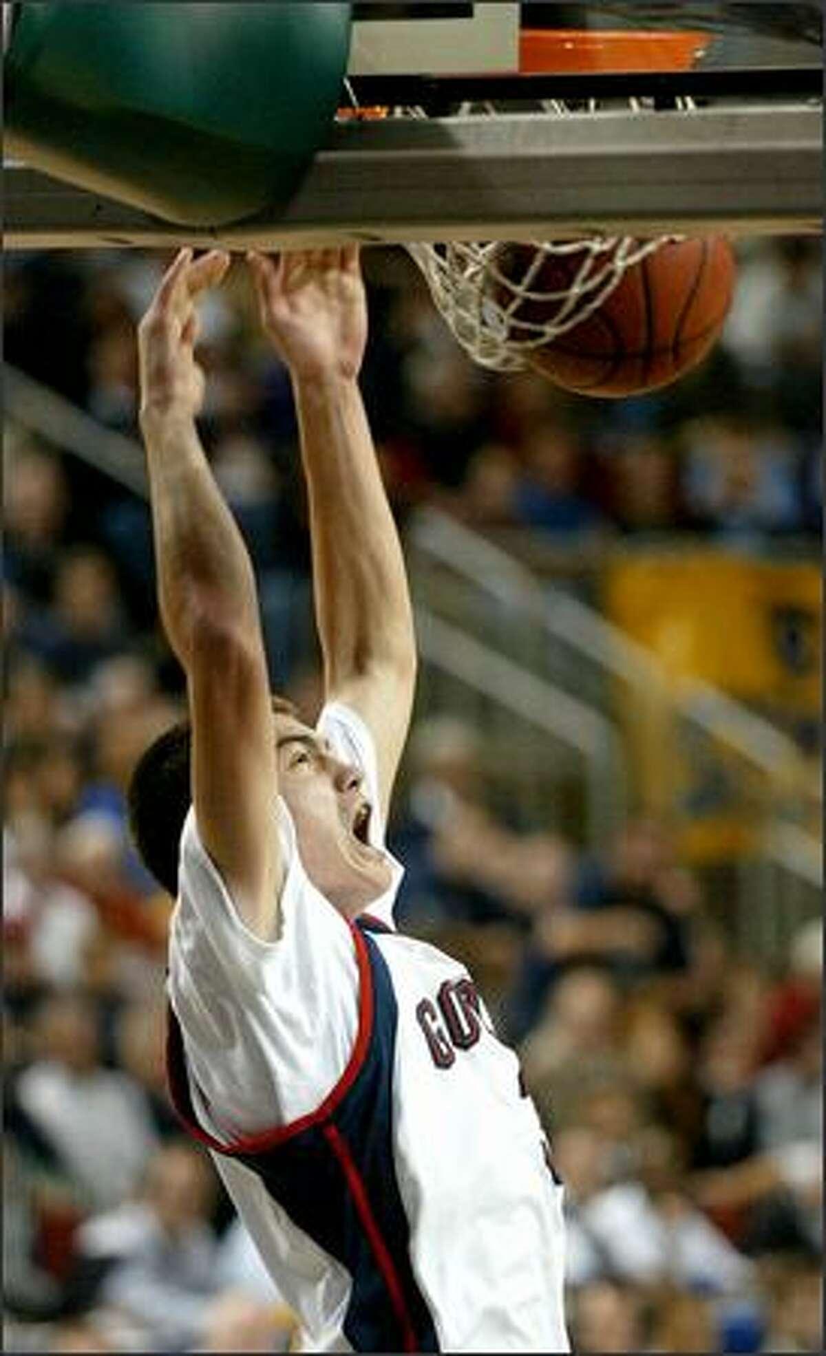 Adam Morrison, a 6-foot-8 freshman from Spokane, slams one down.