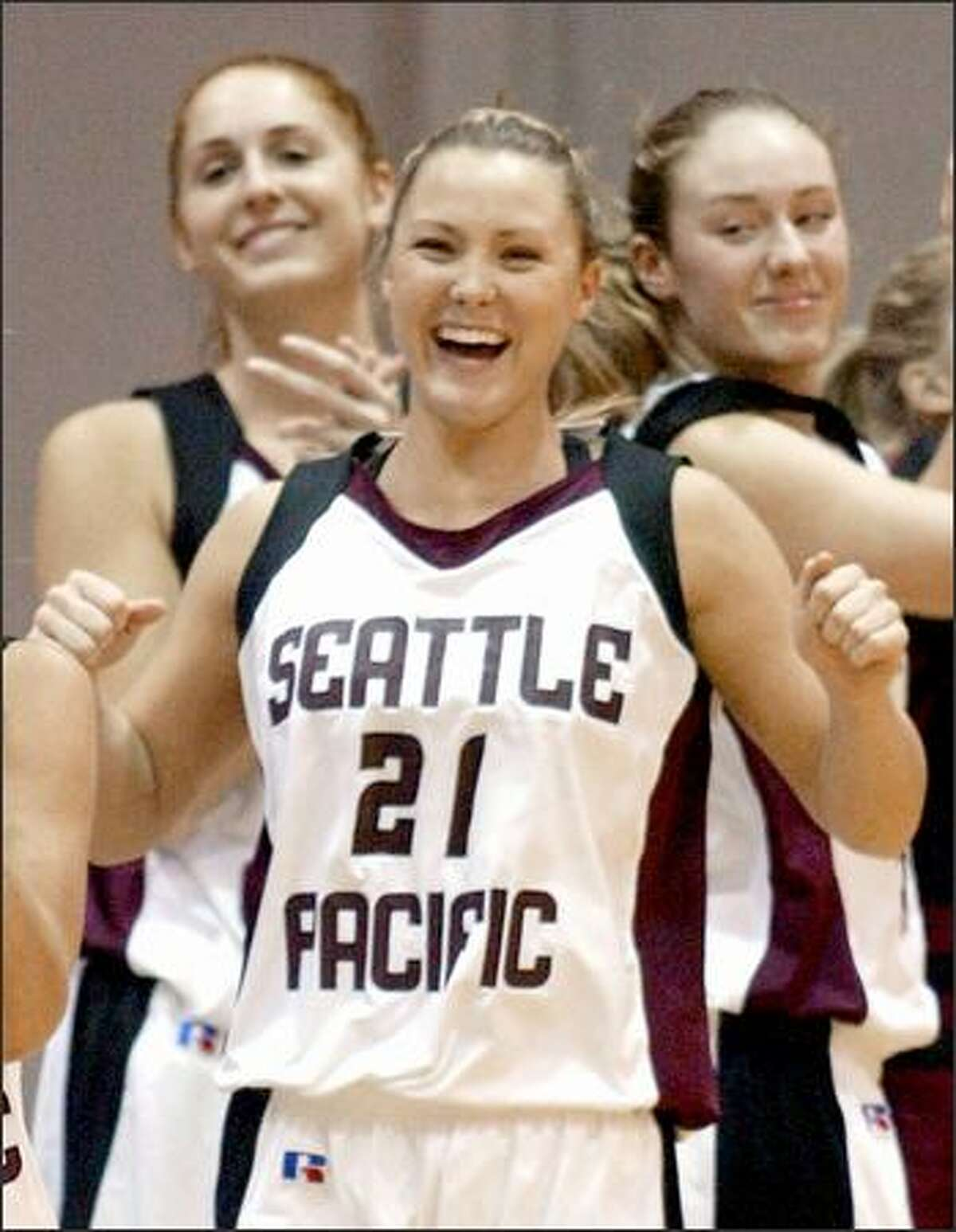 Sophomore Jenny Poe, two years behind big sister Kristin, is one happy Falcon after Seattle Pacific advanced to the national quarterfinals.