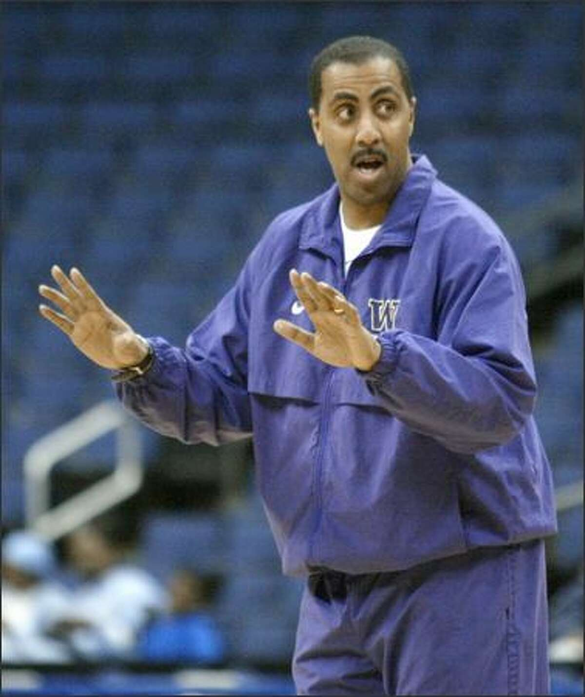 """Huskies coach Lorenzo Romar has watched the UW's loss to UAB three times on video. The lucky 3-pointer by Squeaky Johnson irks him. """"We had momentum at the time,"""" he said."""