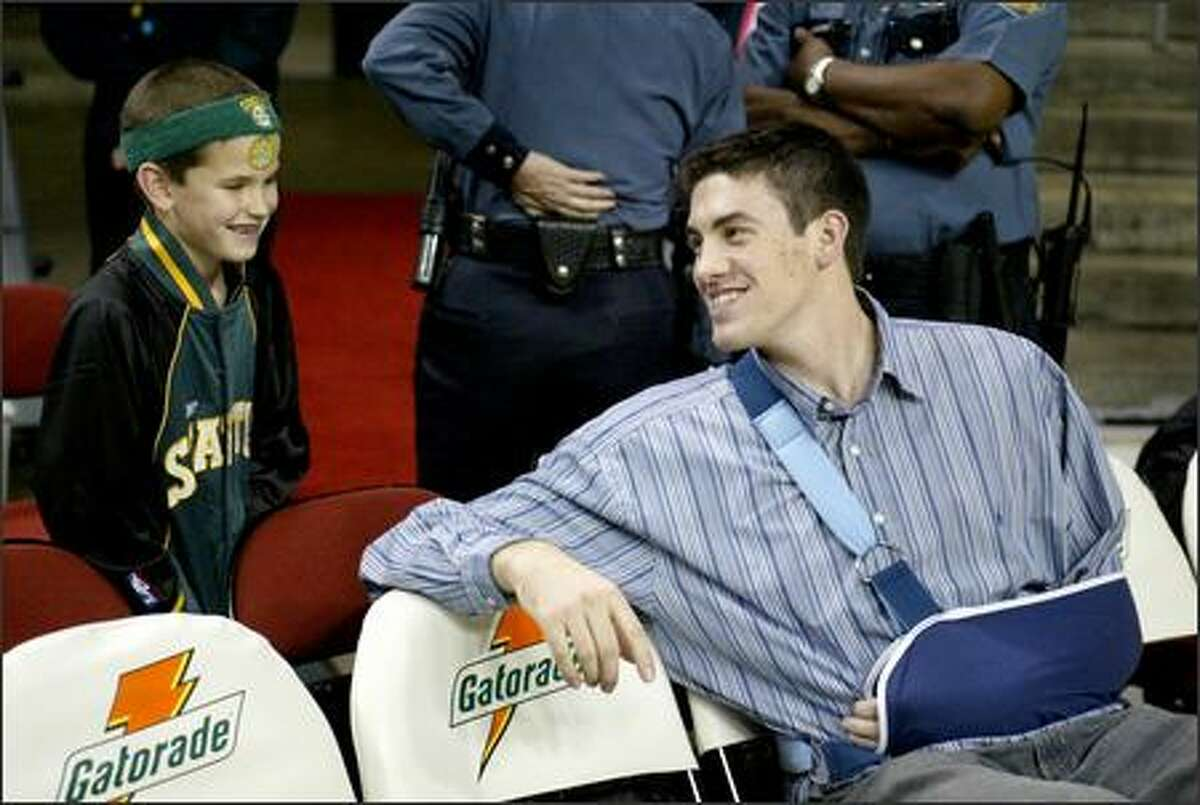 Sonics rookie forward Nick Collison chats with fan Cort Thoreson before an exhibition game against Golden State in October.